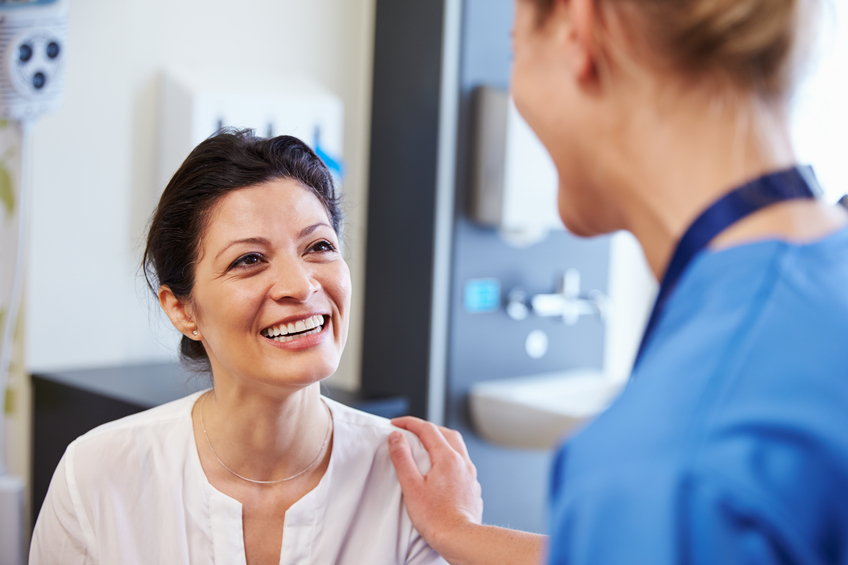Woman smiling at doctor.