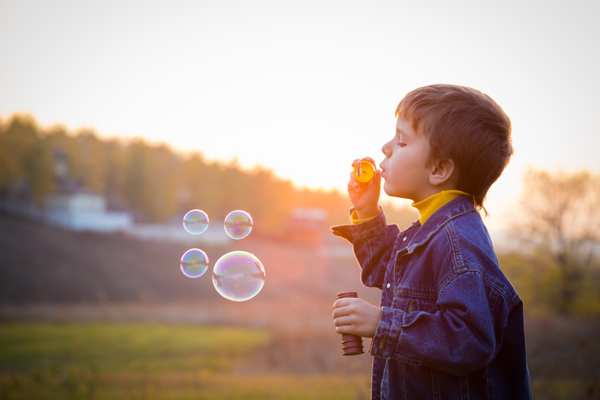 Boy blowing bubbles.